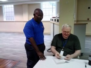 Julius Thompson (Stage Captain) assisting legendary Pat Conroy at Decatur Book Festival